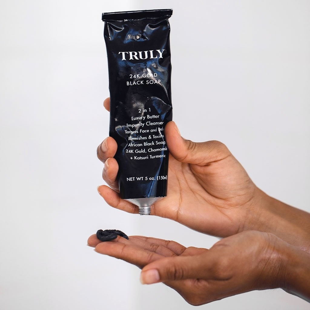 A model squeezing product from the tube