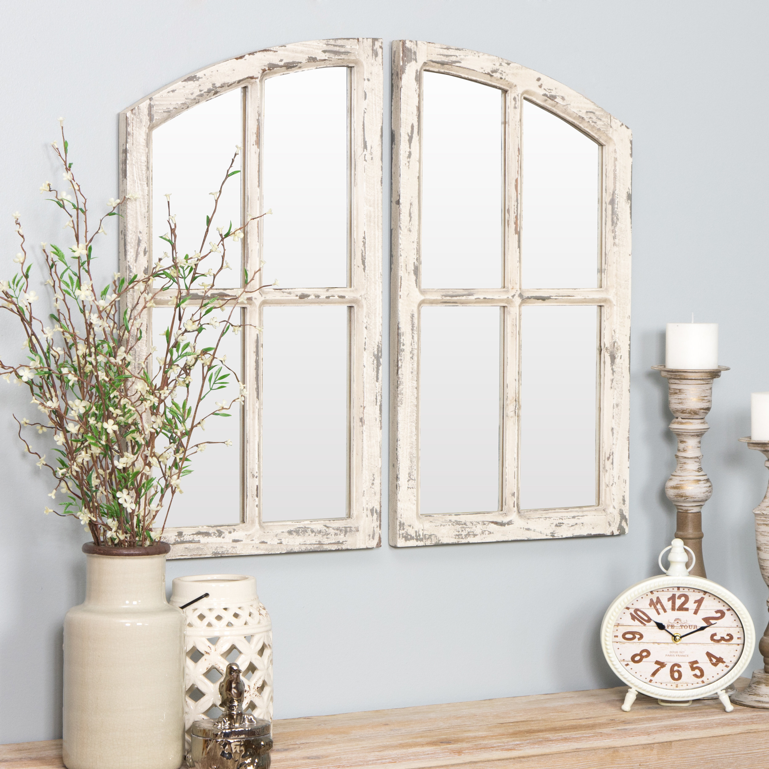 The white rustic window pane mirrors on the wall