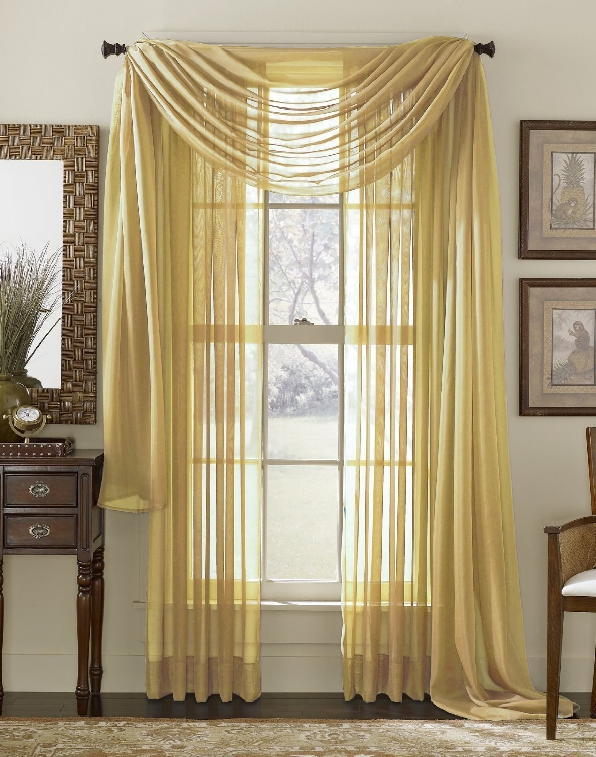 Draped golden sheer curtains on a window