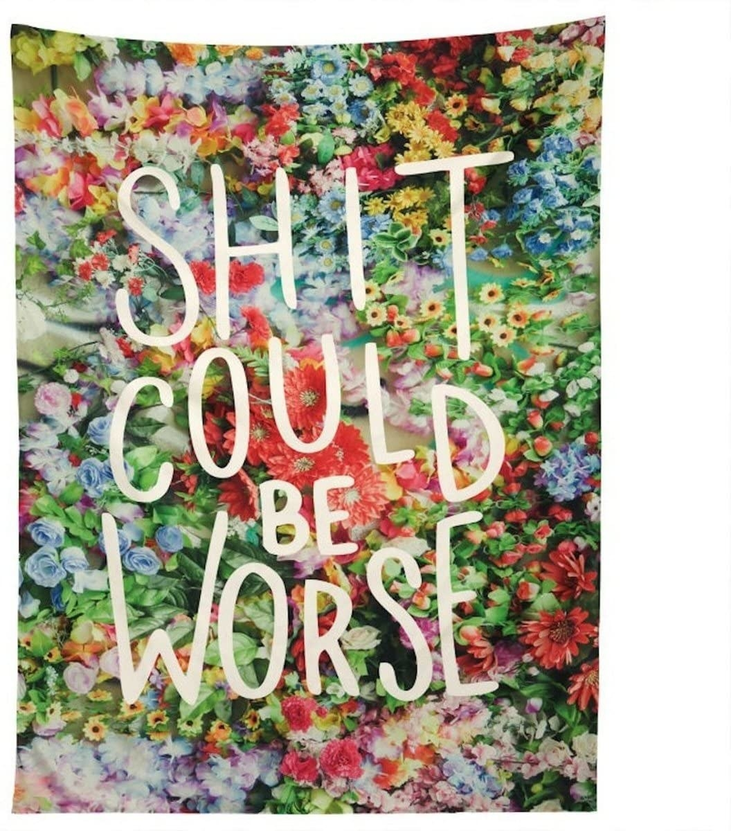 A floral blanket that says shit could be worse