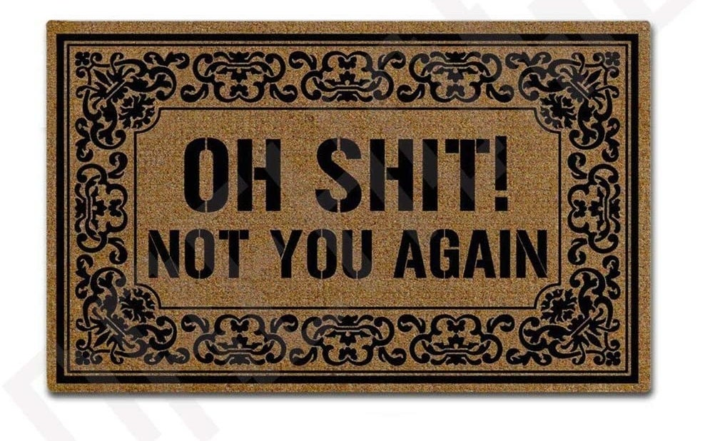 A doormat that says oh shit not your again