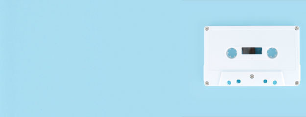 White cassette tape with baby blue background