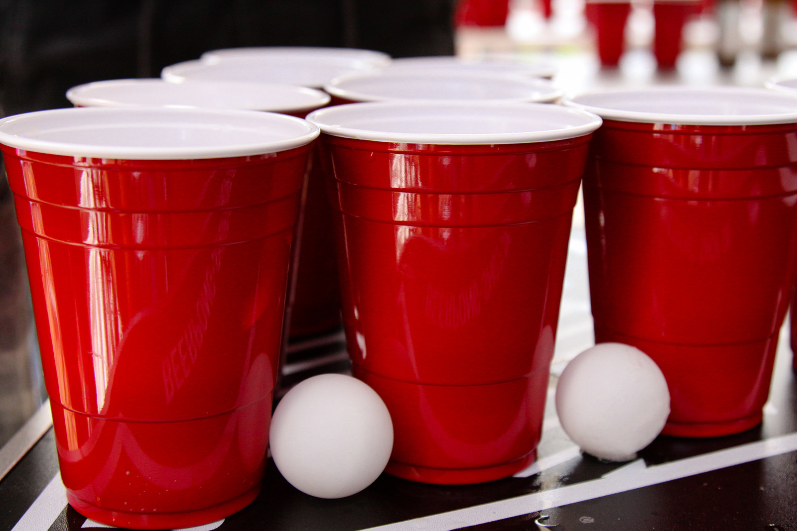 Red plastic cups set up for beer pong.
