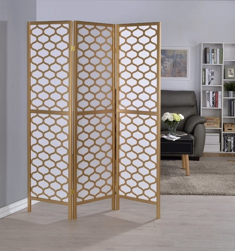 A white and gold room divider with three panels that can fold up