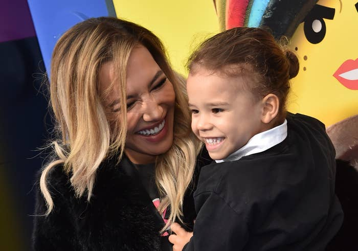 Naya Rivera smiles and poses with her son at a red carpet event