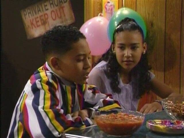 """Tahj Mowry as TJ Henderson and Naya Rivera as one of his dates for a school dance in """"Smart Guy"""""""