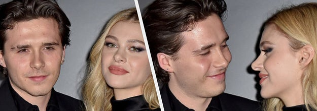 Brooklyn Beckham and Nicola Peltz on a red carpet side-by-side with them looking at each other