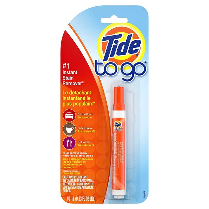 A Tide To Go stain-removing pen inside its packaging