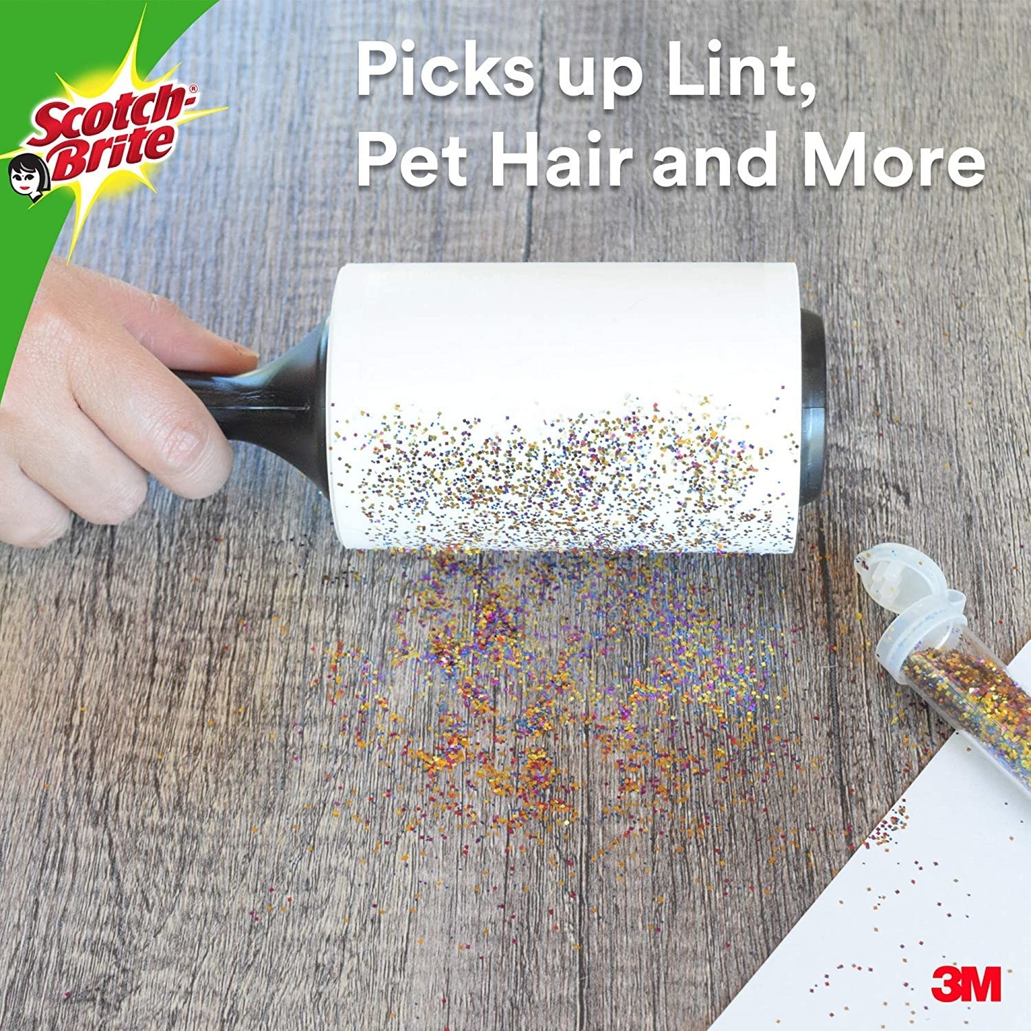 A Scotch-Brite roller being used to pick up glitter from a wooden table