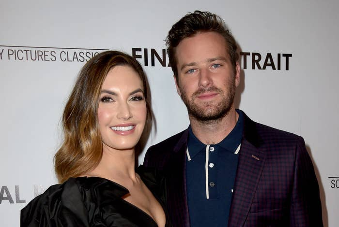 Elizabeth Chambers and Armie Hammer on a red carpet
