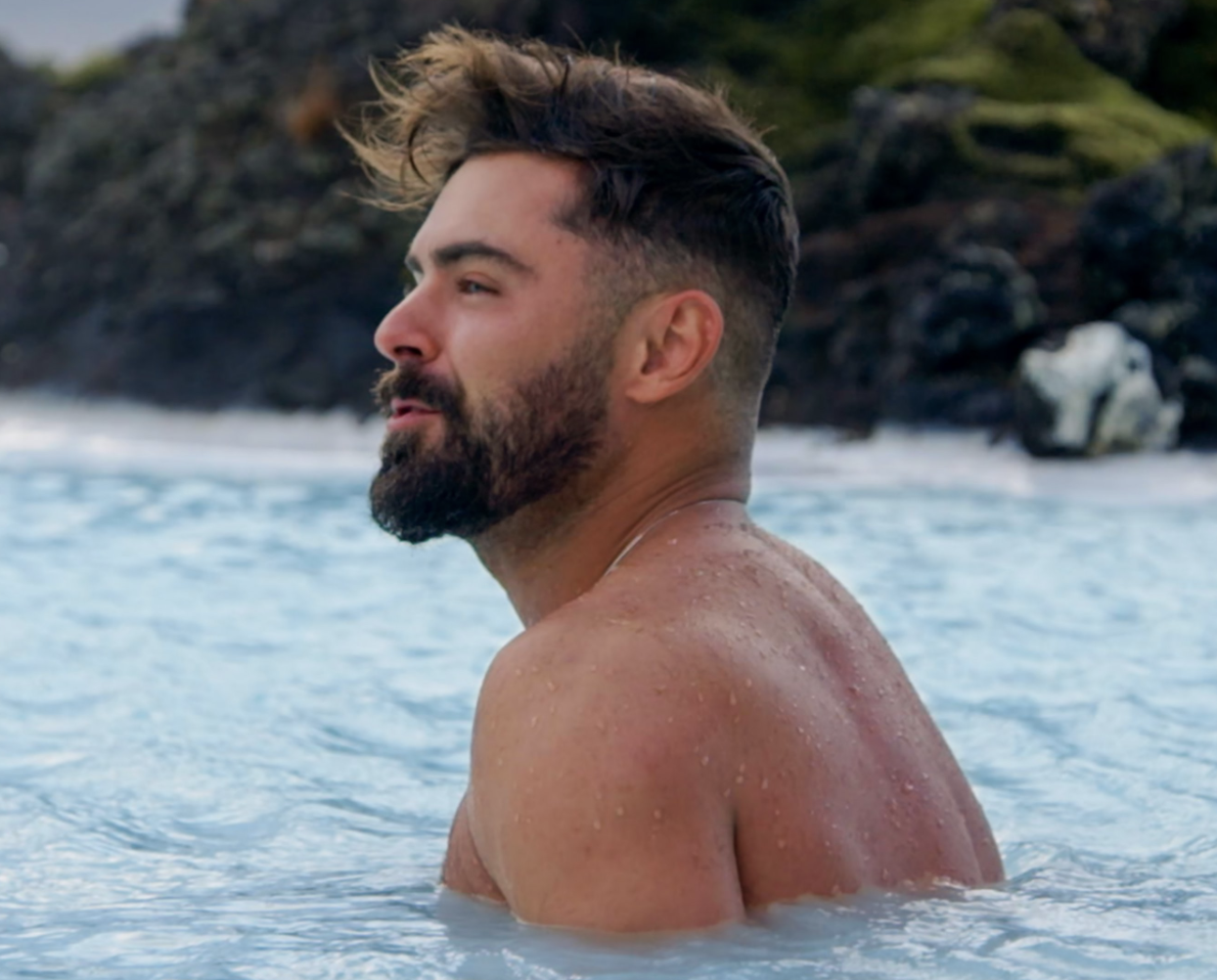 """Zac Efron in the ocean in """"Down To Earth."""""""