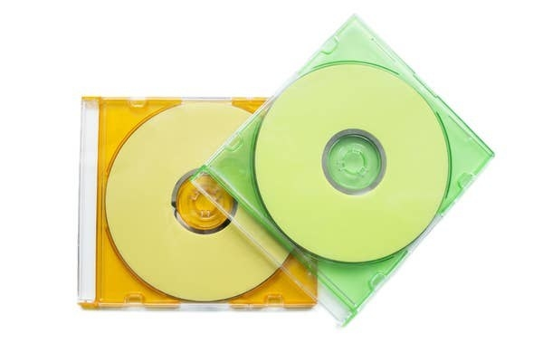 Photo of two blank CDs in skinny jewel cases.