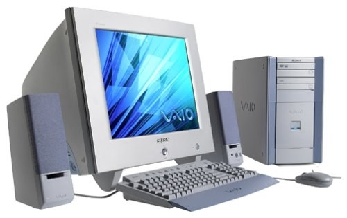 A early 2000s Sony Vaio computer which features the tower, a corded mouse and keyboard, and external portable speakers.