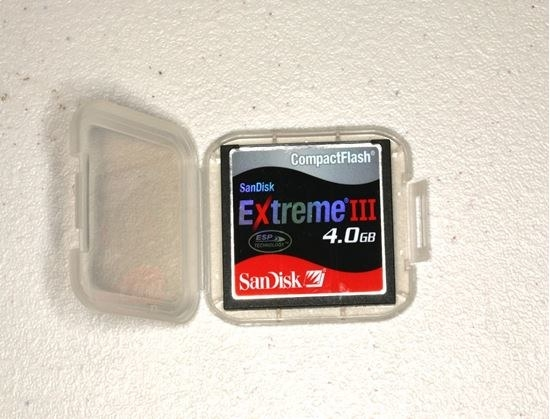 A photo of 4.0 GB memory card in its plastic case.