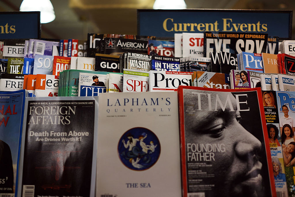 A close up of several different current events magazines on a magazine rack at a Barnes & Noble.