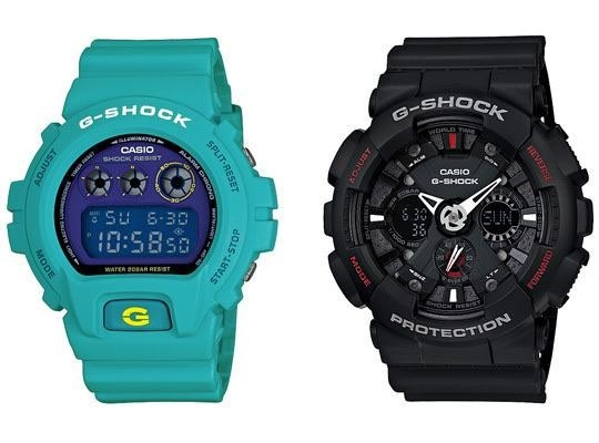 Two Casio G-Shock watches, one teal and one black, from the early 2000s.
