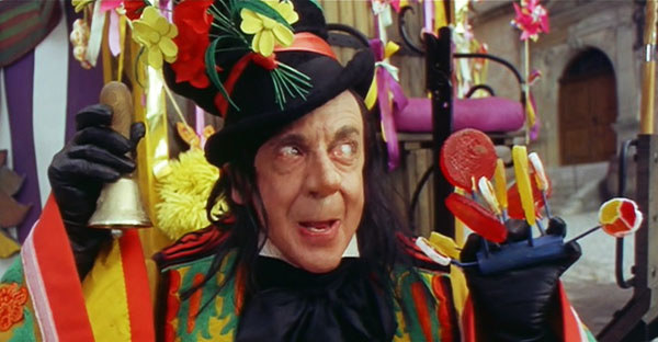 The Child Catcher with a bell and candy