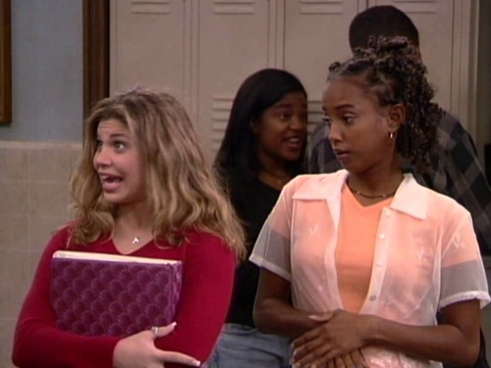 "Topanga holds a binder and Angela looks over her shoulder in ""Boy Meets World"""