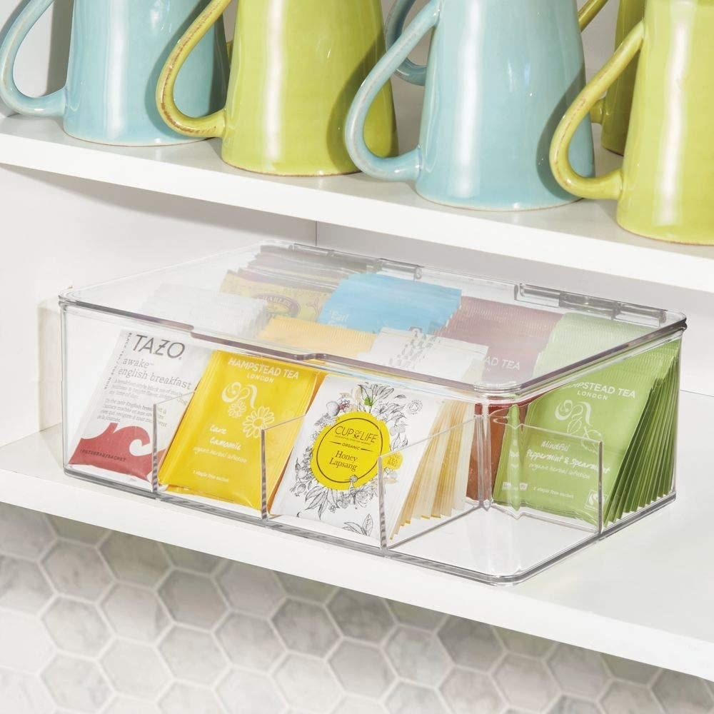 The tea sachet organizer filled with packages of tea