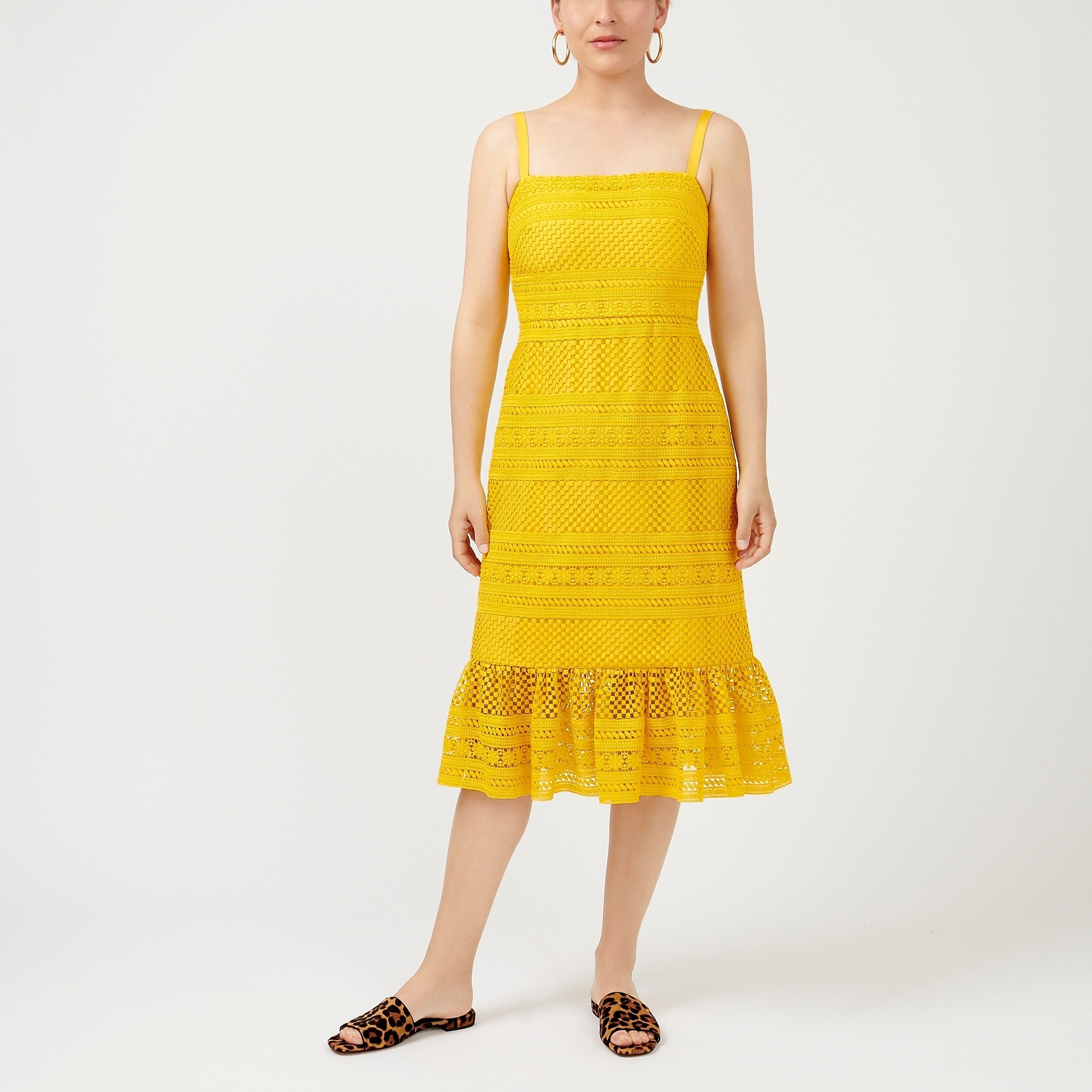 model wearing yellow lace midi dress