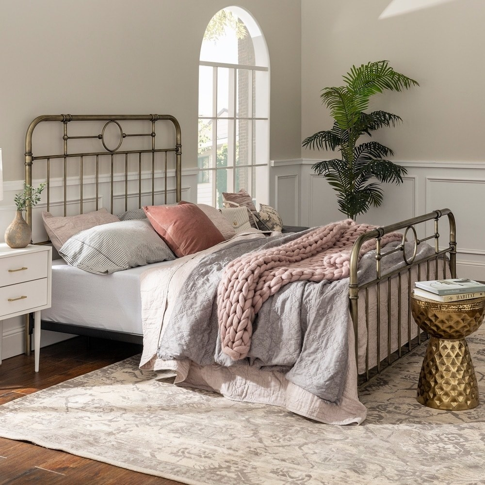 an antique finish metal pipe bed