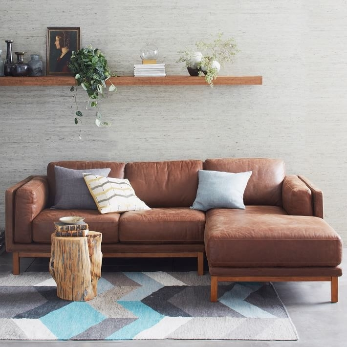 a brown leather two-piece sectional