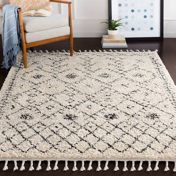 black and white rug with tassel trim