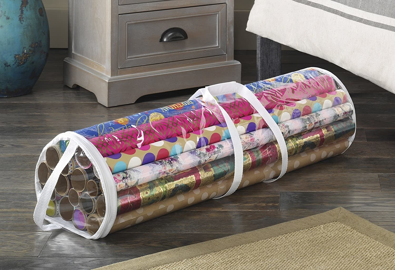 A gift wrap tote filled with rolls of wrapping paper