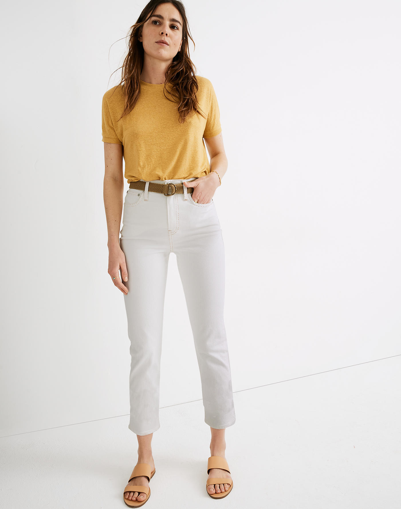 Model wearing the cropped white high-waisted straight jeans