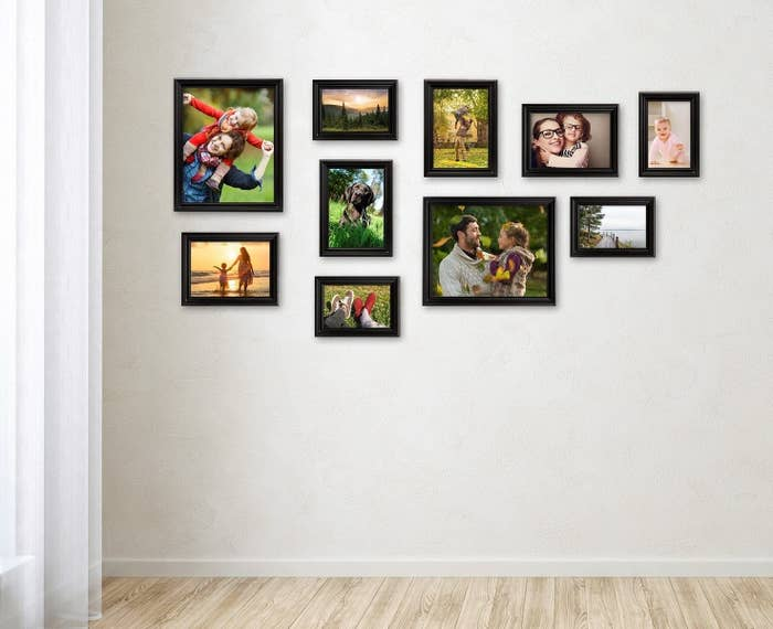 Multiple frames hung on a wall to make a gallery wall.