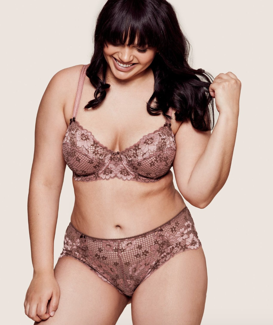 model wearing pink lace matching underwire bra and underwear