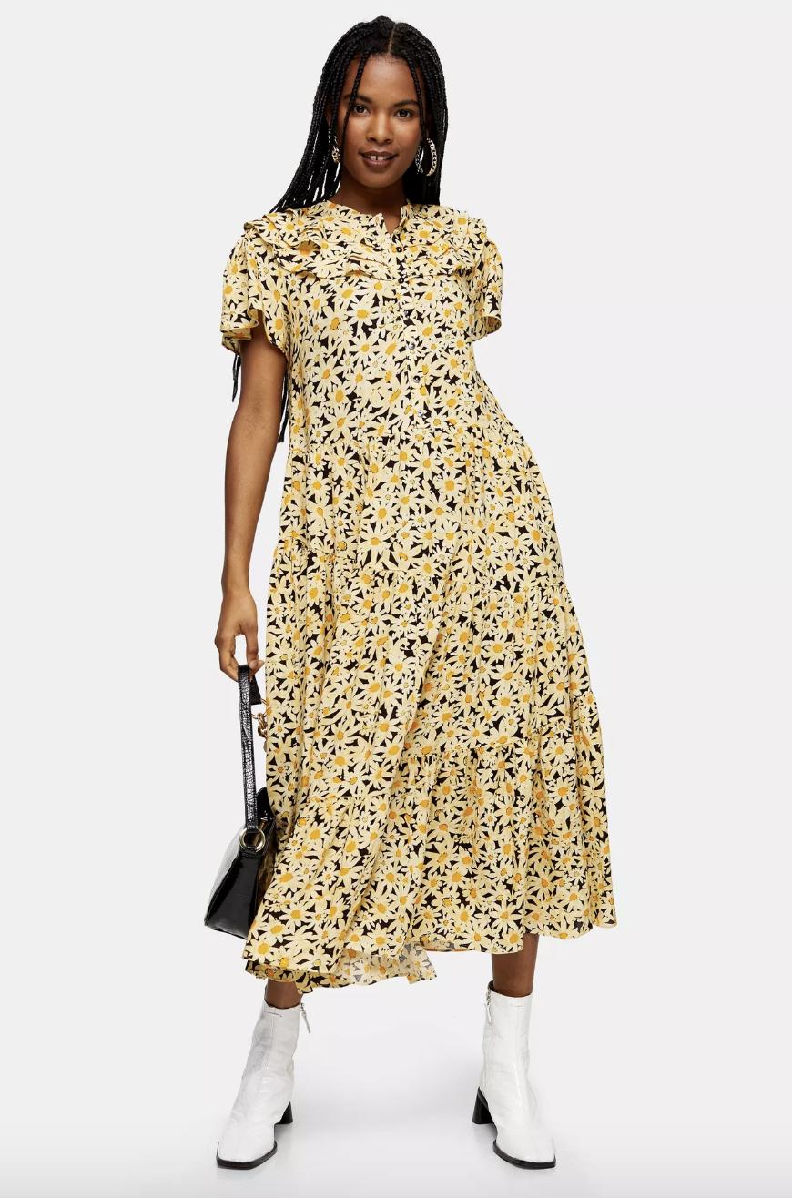 model wearing yellow floral midi dress