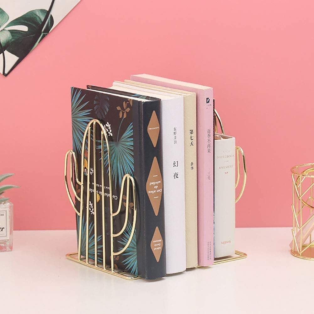 The cactus bookends in gold.