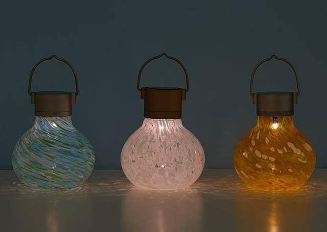 Three solar tealights in mint, snow, and saffron