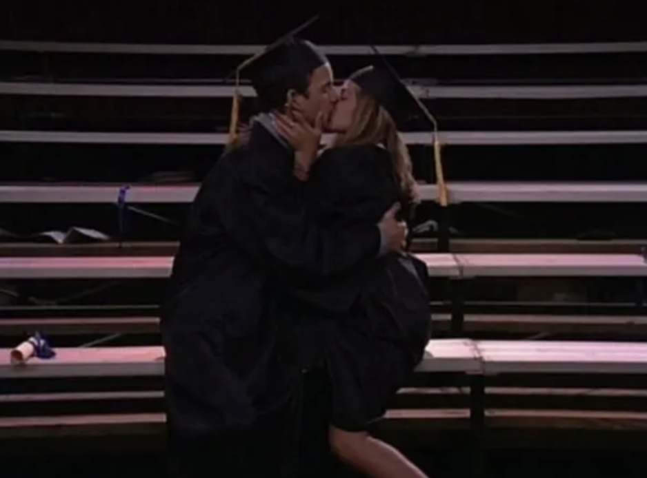 Cory and Topanga kissing in their graduation cap and gown