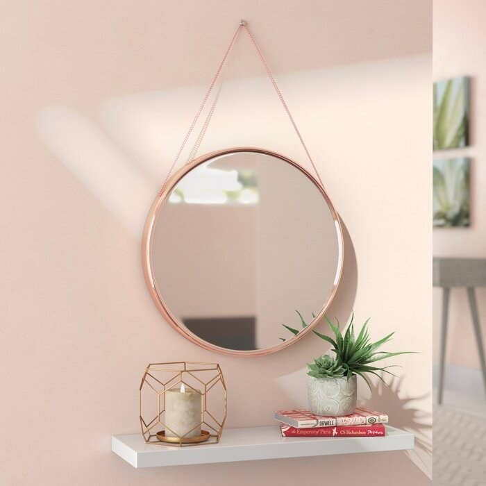 Rhein accent mirror in rose gold finish with a hanging chain