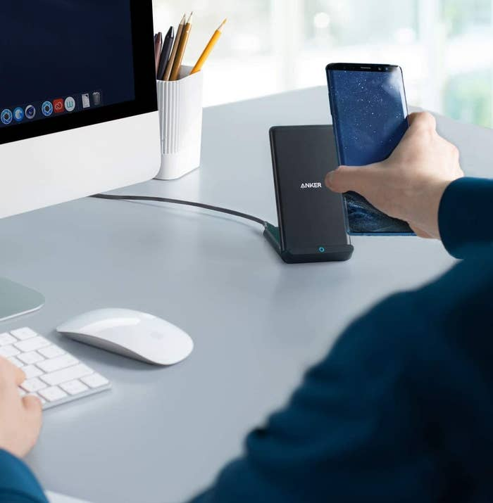 A person using a wireless charger