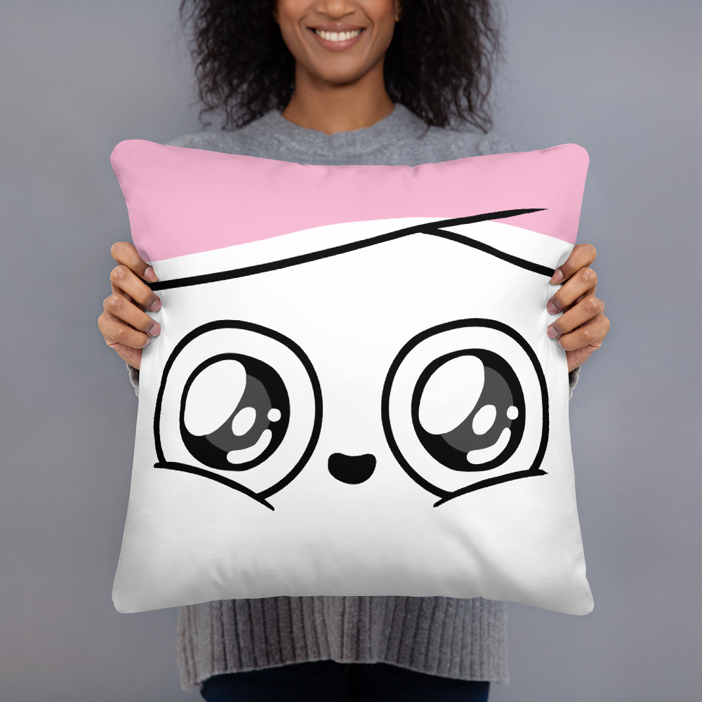 A model holding the square pillow with a close-up of Cuppy's face with wide, adoring eyes and a smile