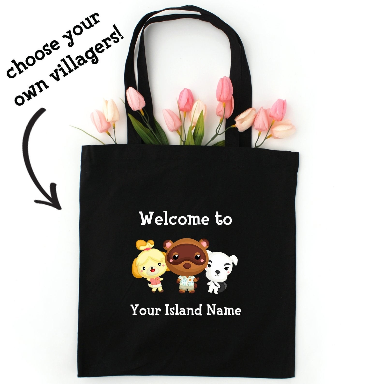 "A black tote bag that says ""welcome to (your island name)"""