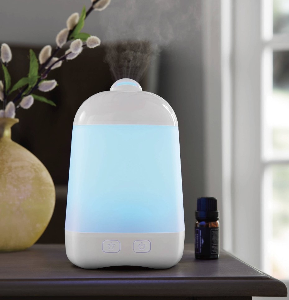 a white diffuser glowing blue