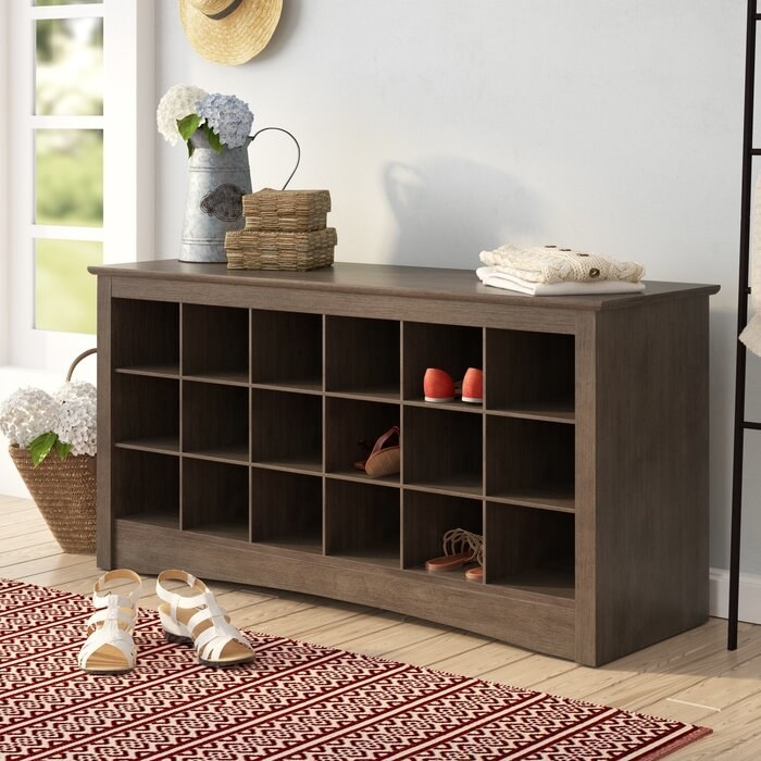 Manzanola shoe storage bench in walnut finish