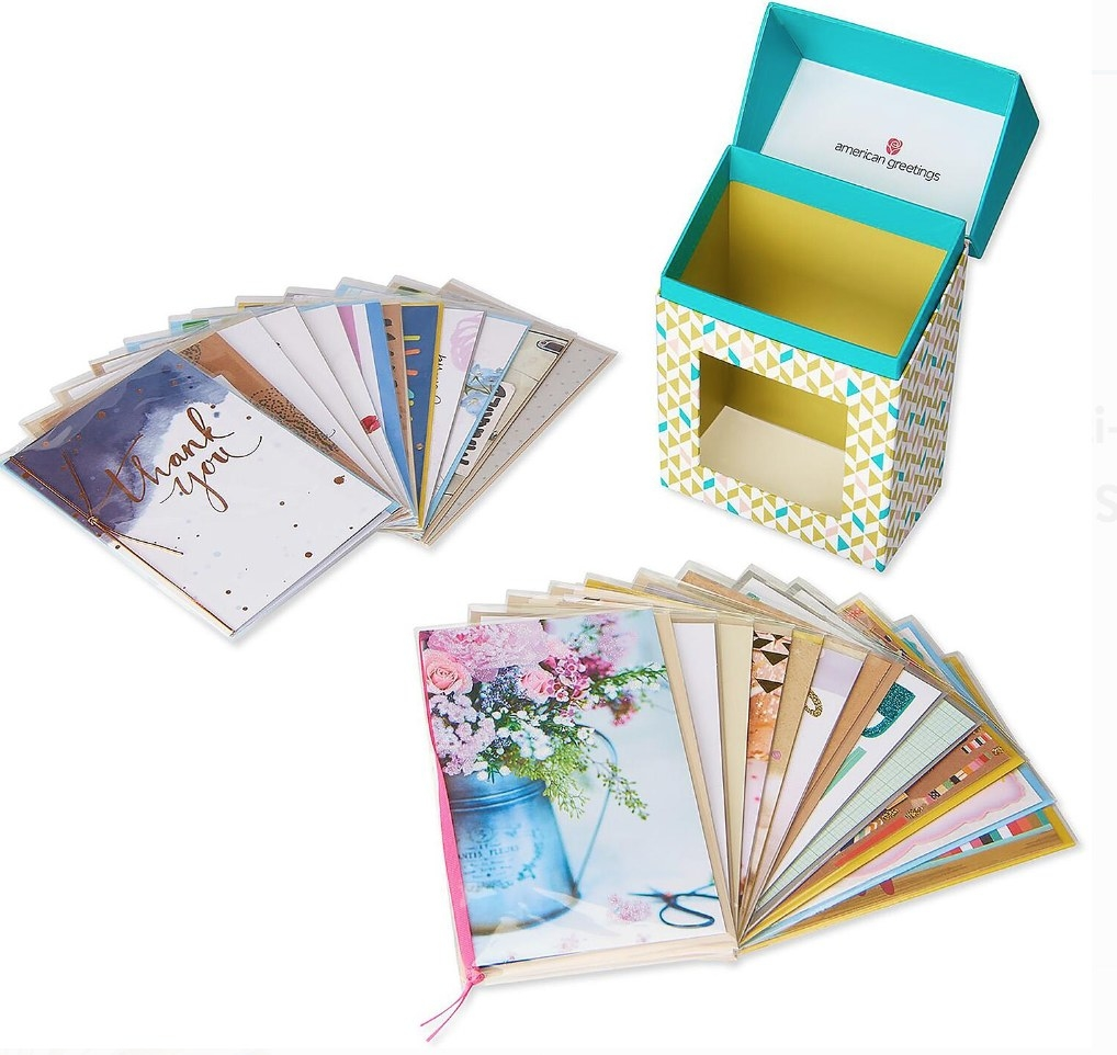 a box of assorted greeting cards