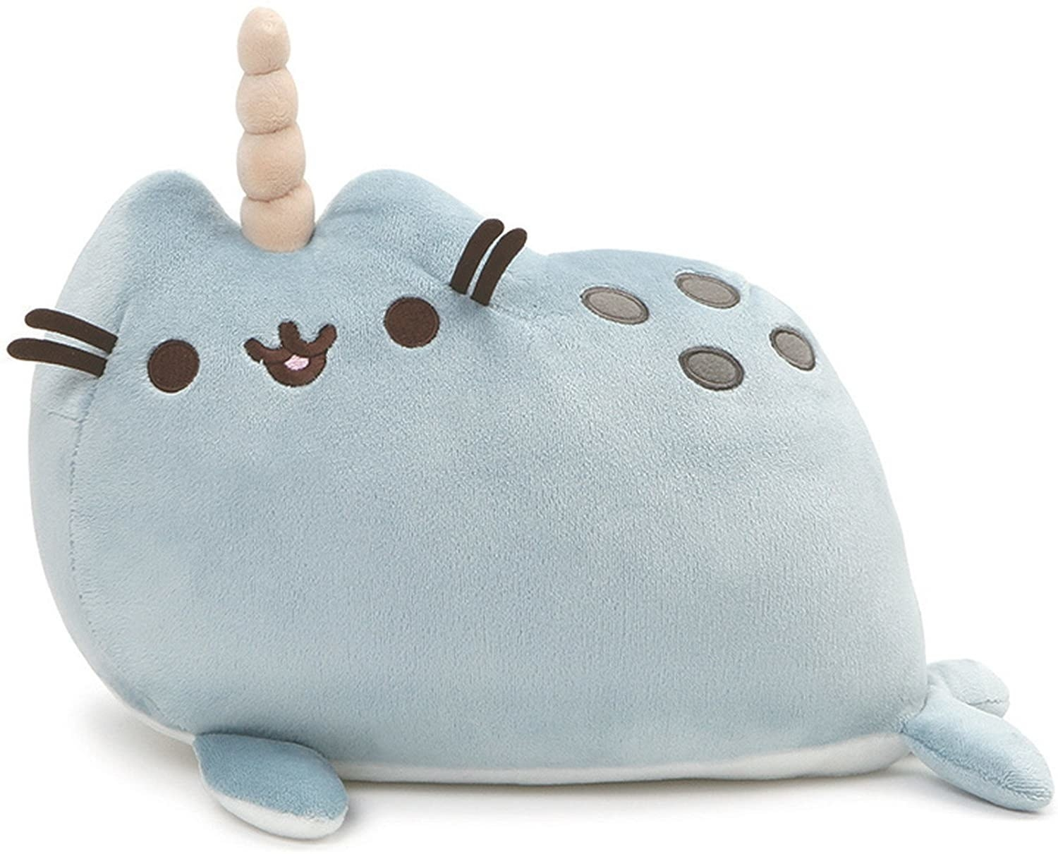 The plush, which has a narwhal horn and body but a Pusheen face, ears, and whiskers