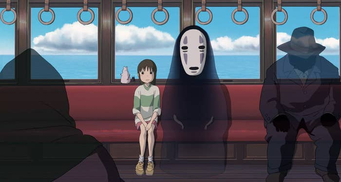"Chihiro and No Face sitting on the train in ""Spirited Away"""