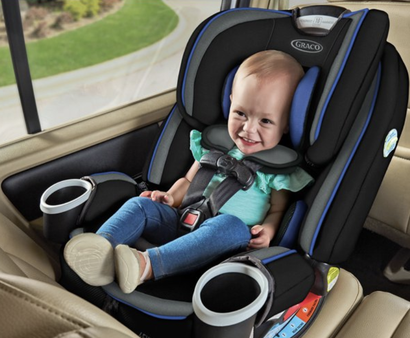A toddler in the car seat