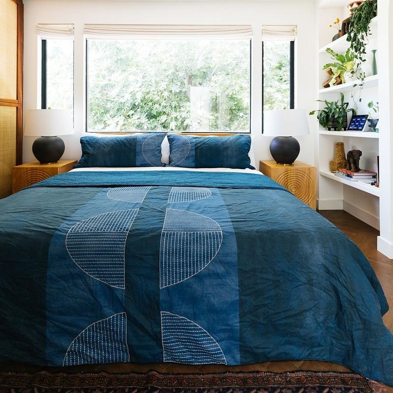 the quilt set on a bed