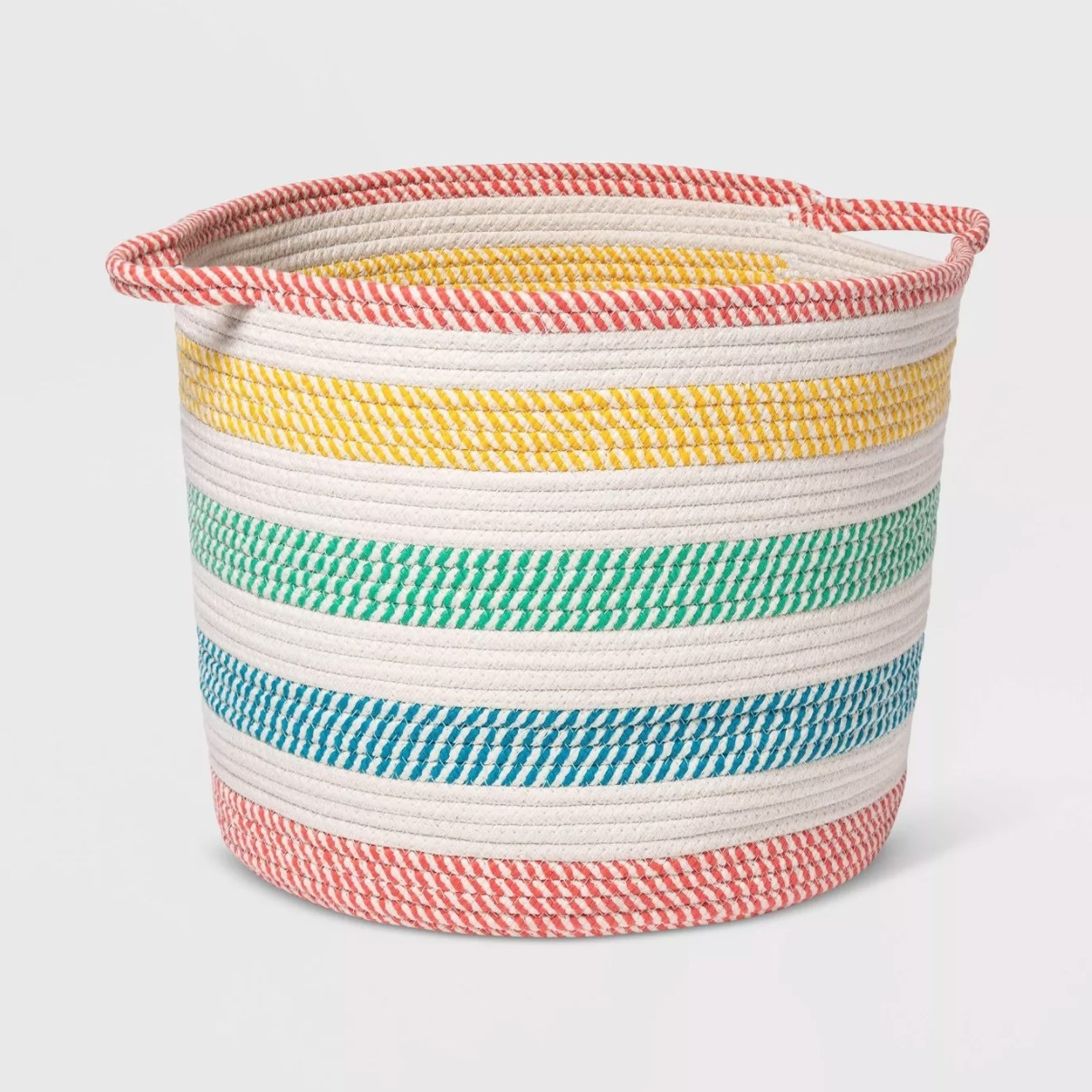 A white rope basket with rainbow-colored stripes