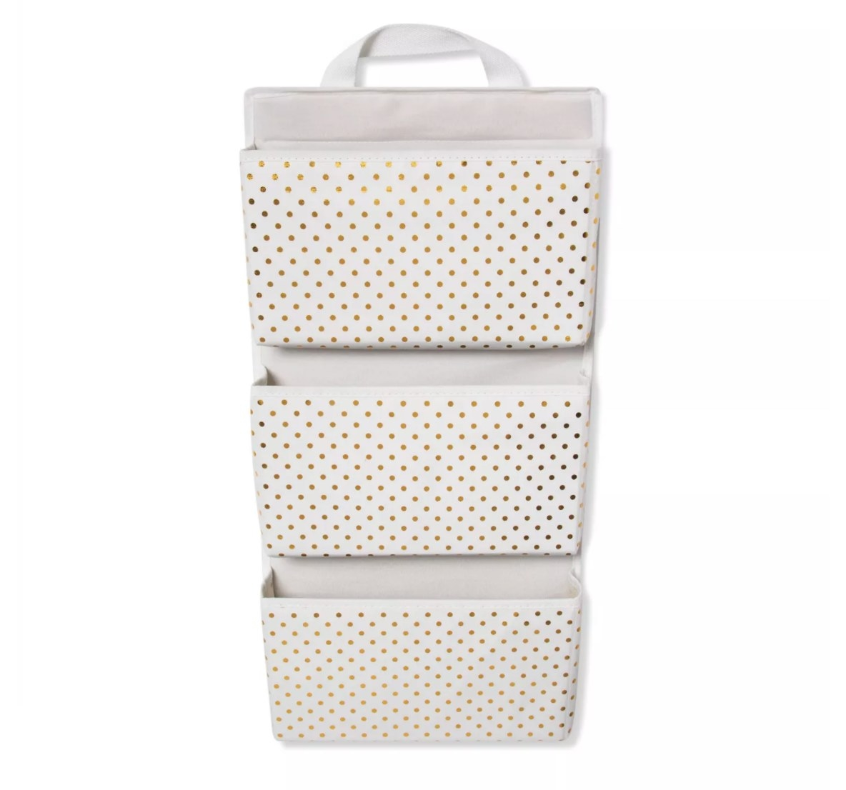 A three-pocket vertical hanging organizer with gold polka dots on white