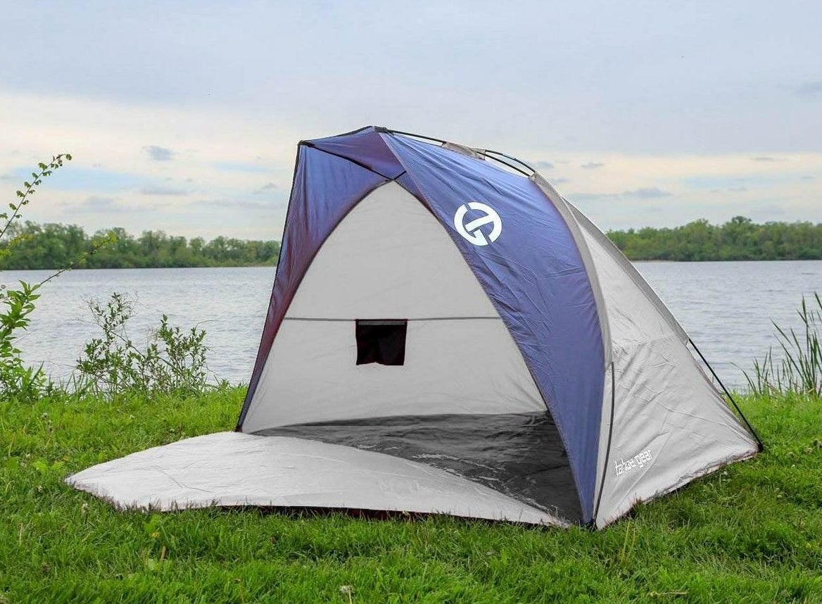 A light gray tent with blue accents