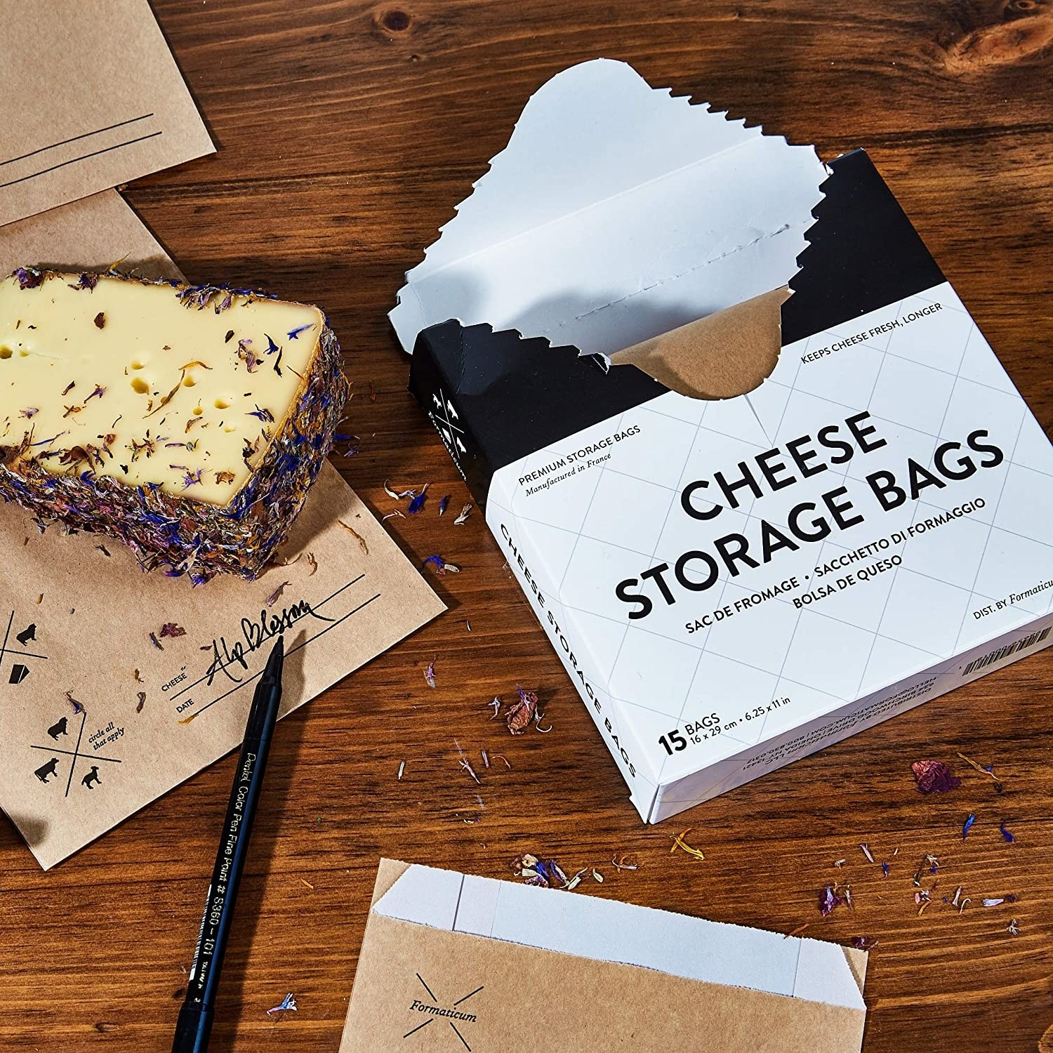 An open pack of cheese storage bags next to a wedge of cheese